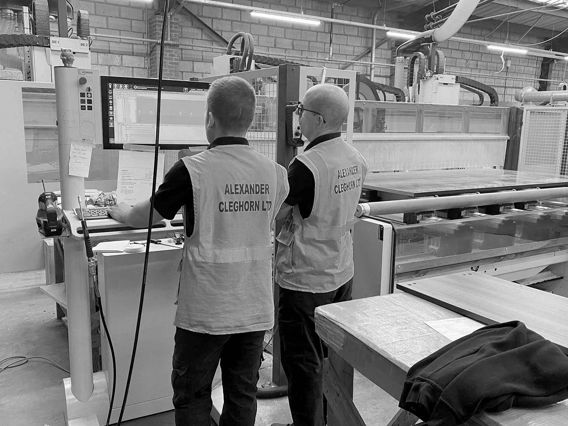 Employees overseeing Computer Aided manufacture process
